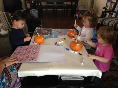 Little J and the girls are hard at work on their pumpkins!
